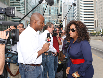 Oprah talks to a reporter.