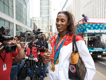 Lisa Leslie talks to the press.