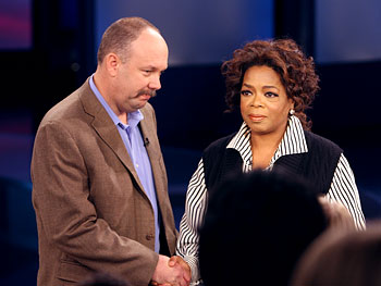Oprah greets Flint Waters.
