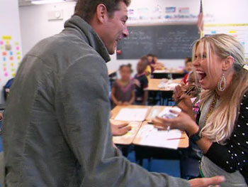 Ty Pennington surprises Amy and Megan at their school.
