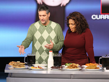 Roger Shultz shows Oprah his old diet.