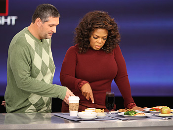 Roger Shultz shows Oprah his new diet.