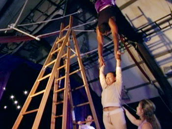 Marcus and Tamica complete the trapeze exercise.