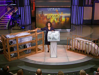 Oprah shows standard animal cages.