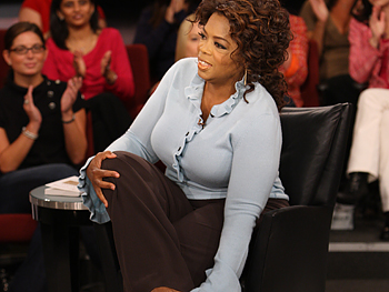 Oprah puts on her shoes.