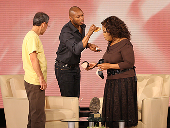 Oprah gets her makeup touched up.