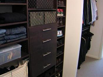 An organized bedroom closet.