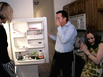 Peter Walsh opens a refrigerator with rotting food inside.
