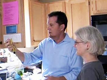 Peter Walsh organizes Babette's kitchen cabinets.