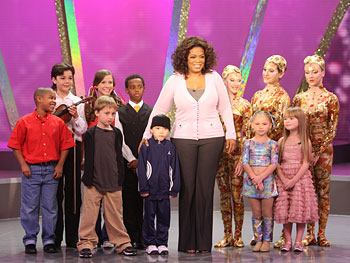 Oprah meets talented children.