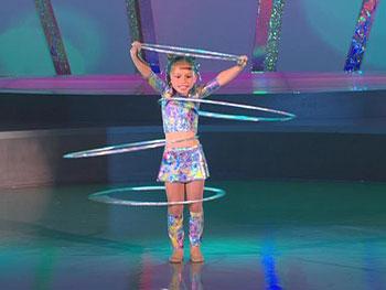 Americus hula hoops on Oprah's stage.