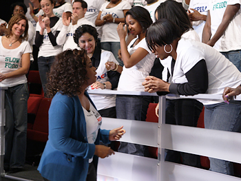 Oprah talks to voters in her audience.