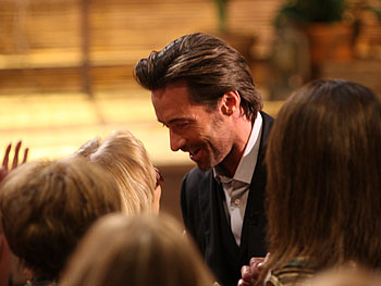 Hugh Jackman greets a fan.