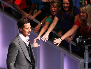 Brad Pitt enters the studio.