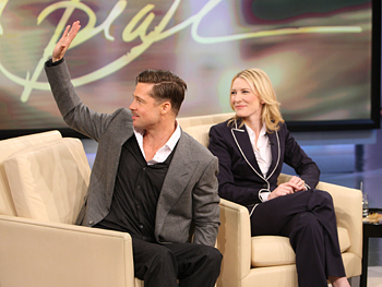 Brad Pitt and Cate Blanchett look at the audience.