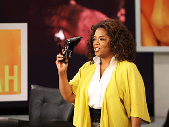 Oprah shows off her shoes.
