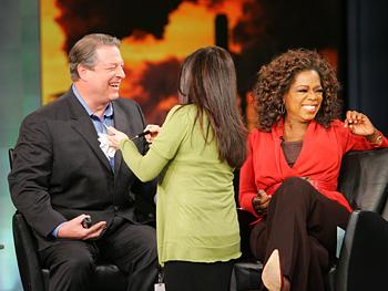 Al Gore gets a makeup touch-up.