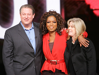 Oprah poses for a photo with former Vice President Al Gore and his wife, Tipper.