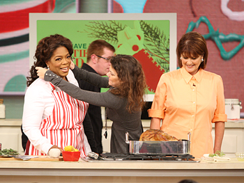 Kelly helps Oprah with her outfit.