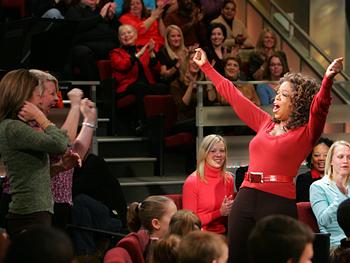 Oprah celebrates.