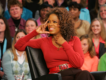 Oprah watches an audience video.