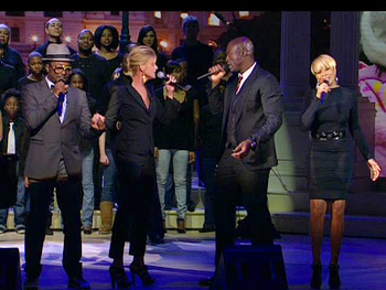 Will.i.am, David Foster, Faith Hill, Mary J. Blige, Seal and Bono perform America's Song.