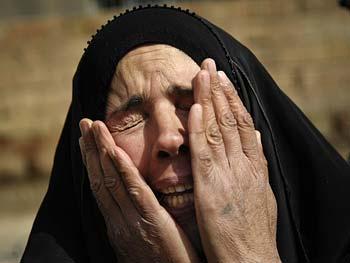 An Iraqi woman wails.