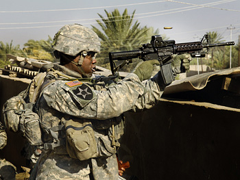 A soldier fires his gun.
