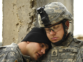 A quiet moment between soldiers