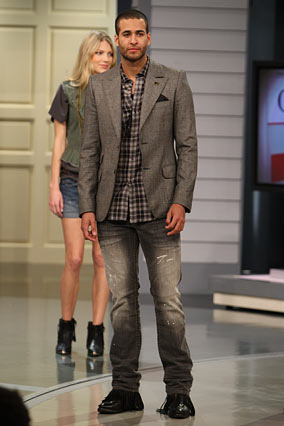 A male model pairs the William Rast Ben jeans with a flannel shirt and optical wave wool blazer.