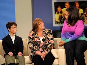 Sandy Swanson surprises the Roach family.
