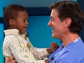 Dr. Oz hugs Stanley, a hurricane survivor.