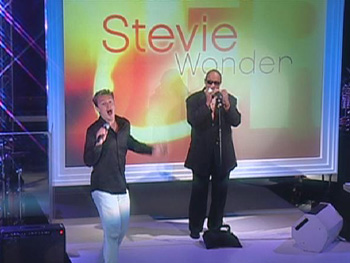 Stevie Wonder surprises Star Search champ Jake Simpson.