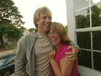Jon Bon Jovi surprises his biggest fan, Beth Mills.