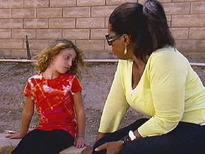 Oprah and Jani Schofield, a 7-year-old schizophrenic