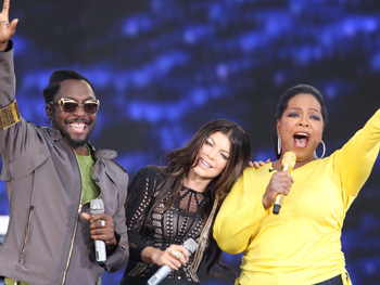 Fergie, will.i.am and Oprah celebrate in Chicago.