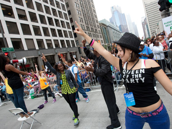 Dancers teach the audience members choreographed steps.