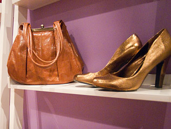 Gold pumps at Oprah's Accessory Boutique