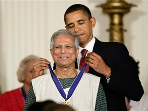 President Obama honors Muhammad Yunus with the Presidential Medal of Honor.