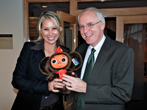 Anna Kournikova presents the U.S. Ambassador with Cheburashka, a Russian animation toy.