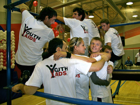 Anna Kournikova gets a demonstration of Parkour at a youth center in Russia.