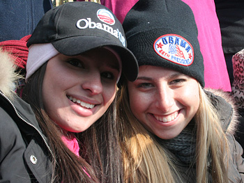 Two girls dressed in Obama hats