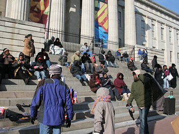 People waiting on steps
