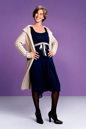 Cable-knit sweater-coat and navy tank dress