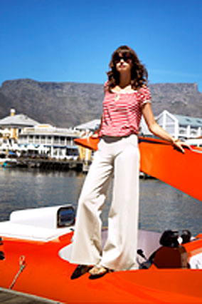 Model on an adrenalin speed boat in Cape Town