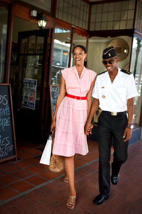 Model with soldier at Gogo's delicatessen in Simon's Town, Cape Town