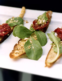 Image of Oven-Dried-Tomato Bruschetta With Almonds And Arugula, Oprah