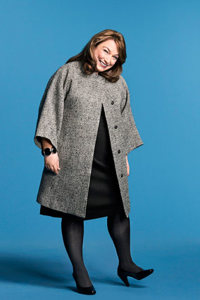 Lisa Kogan models a Calvin Klein coat.