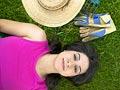 Woman lying in garden