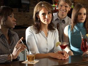 Women sitting at a bar